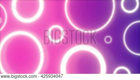 Pulsating white neon rings in various sizes glowing on pink and purple background. energy, electricity, luminosity, colour and movement concept, digitally generated image.