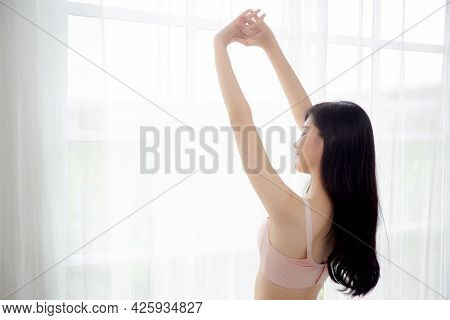 Beautiful Young Asian Woman Waking Up In The Morning Stand Stretching Arms In The Bedroom, Sexy Girl