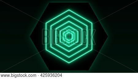 Image of glowing formation of green hexagons flashing on seamless loop. colour and movement concept digitally generated image.