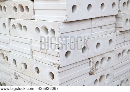 Gypsum Hollow Pazogrebnevye Plates For Partitions Or Internal Walls Are Stacked In A Pile On A Const