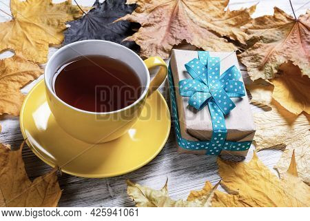 Flat Lay Autumn Composition With Gift Box And Cup Of Black Tea. Time Of Tea Break. Happy Thanksgivin