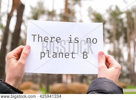 Female Hands Holding White Paper Sheet With Text There Is No Planet B Outdoors. Nature Background. P