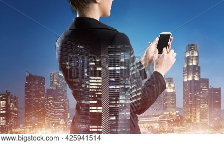 Businesswoman Using Tablet Computer. Double Exposure Concept With Night City And Woman In Business S