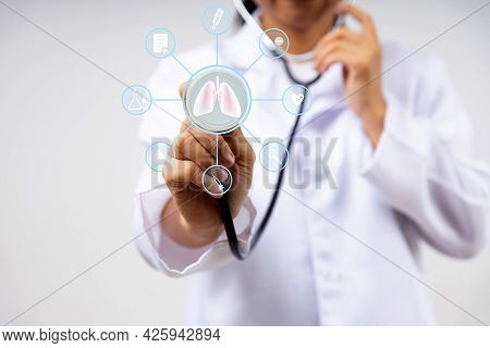 Digital Screen Icon And Doctor In Uniform Use Stethoscope To Check Lung