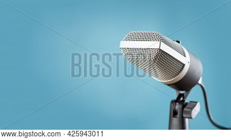 Microphone For Audio Record Or Podcast Concept, Single Microphone On Soft Blue Background  With Copy