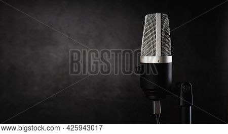Microphone For Audio Record Or Podcast Concept, Single Microphone On Dark Shadow Background  With Co