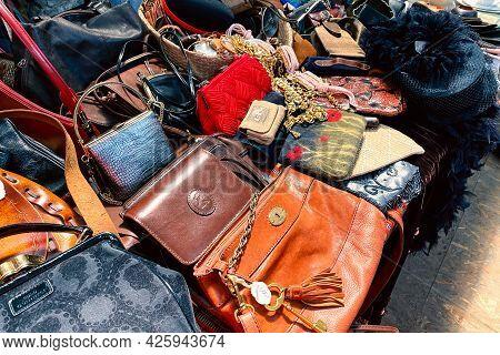 Lviv, Ukraine - May 16, 2021 : Vintage Luxury Leather Bags And Other Vintage Things On Flea Market O