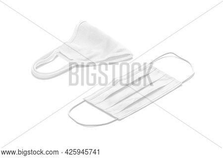 Blank White Medical And Fabric Mask Mockup Lying, Side View, 3d Rendering. Empty Medicine Respirator