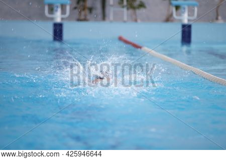 An Athlete Is Swimming In The Sports Pool.