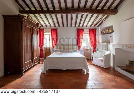 Interior of a double bedroom. Spartan ambiance and nothing luxurious. Front view and the tend are red.