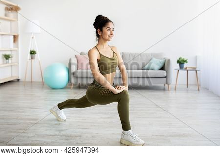 Pretty Young Indian Lady Making Lunge, Doing Strength Exercises, Working Out Booty And Legs Muscles