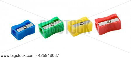 Four pencil sharpener with different colors isolated on a white background