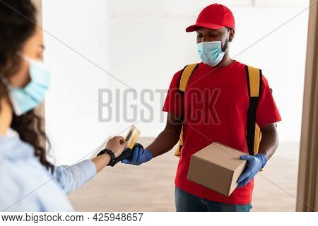 Black Man Holding Pos Machine Lady Paying With Debit Card