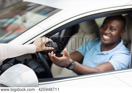 Black Man Taking Key From Auto, Renting Car For Trip