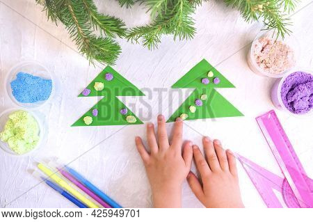 Child Makes A Greeting Card Christmas Paper And Foam Plasticine Craft. Made With His Own Hands. Craf