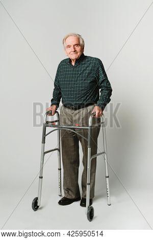Caucasian elderly man with a walker