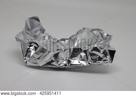 Crumpled Aluminum Foil, Eco Friendly Packaging, Silver Background