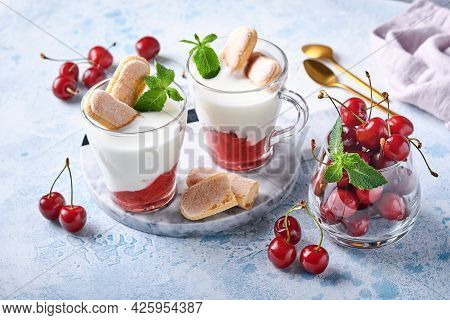 Summer Cherry Puff Pastry With Savoiardi Cookies And Cream Cheese In Glass On Light Grey Background.