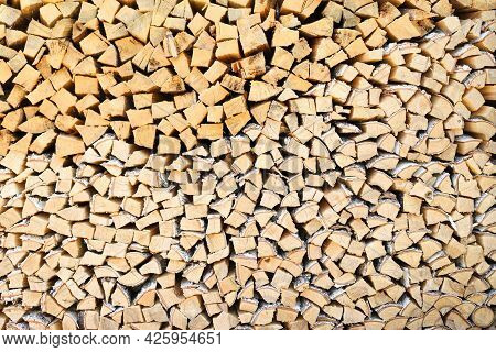 A Lot Of Firewood Stacked Evenly, Texture. Dry Birch And Pine For Furnace. Logs Background. Wooden B