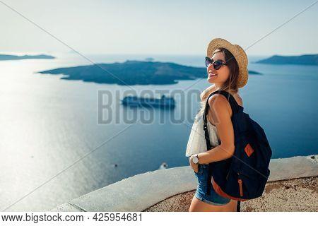 Woman Tourist Enjoying Caldera Sea Landscape In Fira, Santorini Island Looking At Aegean Sea And Shi