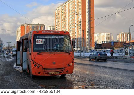 Balashikha, Russia - March 19, 2021. Spring Is In The City. Orange Bus With Number 447 Stopped Next
