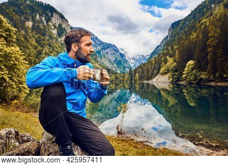 Traveling outdoor hiking and camping lifestyle in nature. Traveling in nature. Man hiker outdoor in nature.Nature lifestyle. Lifestyle camping in Nature. Hiker camping in nature. Hiking and camping. Nature and beautiful mountain view in nature. man hiker