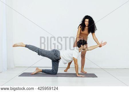 Man Engaged In Yoga With Asana Gymnastics Fitness Instructor
