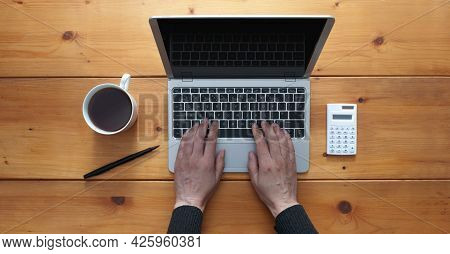 Aerial View Of Hands Typing On A Laptop