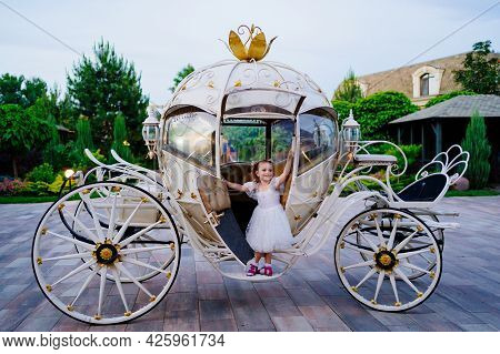 Little Girl In The Carriage. A Fabulous Holiday For A Child.
