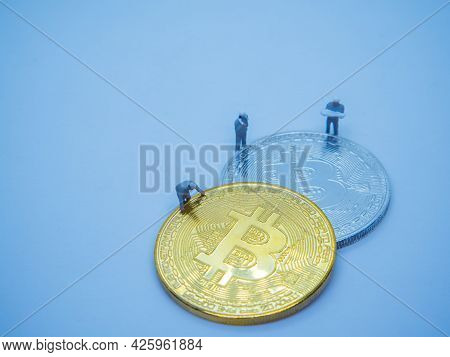 Miniature Mechanic Working On Golden Coins Of Bitcoin Cryptocurrency Digital Bit Coin Btc Currency O