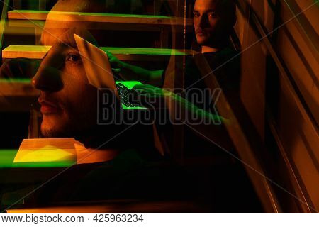 Cinematic Portrait Of Handsome Young Man In Neon Lighted Room, Stylish Male Model Indoors