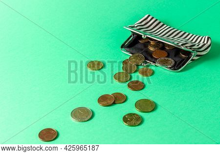 A Wallet With A Change On The Green Background. Poverty Concept. Rich And Poor. Below The Poverty Li