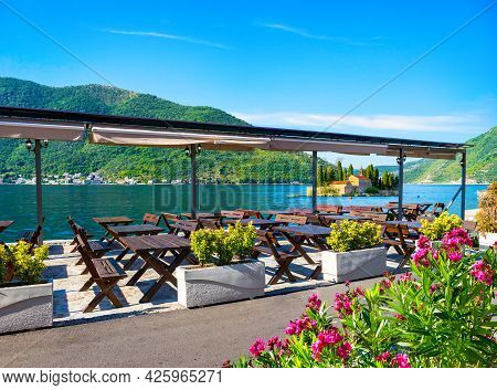 Cafe In Perast On A Background Of Saint George Island