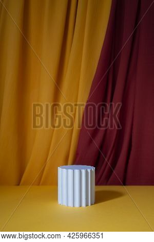 White Podium For Product Presentation. Orange Red Background With Drapery Cloth. Mockup Background W