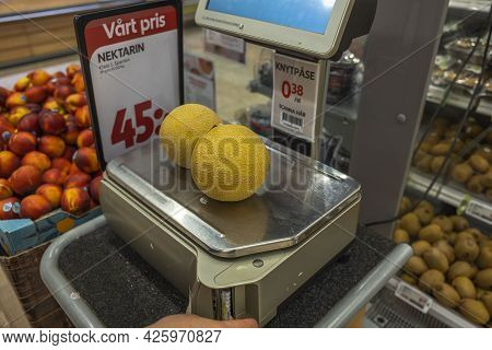 Close Up View Of Yellow Melon On Weighing Scales In Supermarket. Sweden. Uppsala. 07.07.2021.