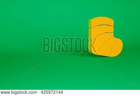 Orange Gypsum Cast Medical Health Broken Leg Icon Isolated On Green Background. Minimalism Concept.