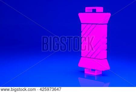 Pink Sewing Thread On Spool Icon Isolated On Blue Background. Yarn Spool. Thread Bobbin. Minimalism