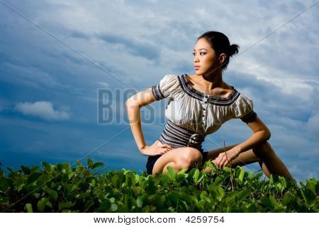 Outdoor Shot Of Fashion Model Squatting