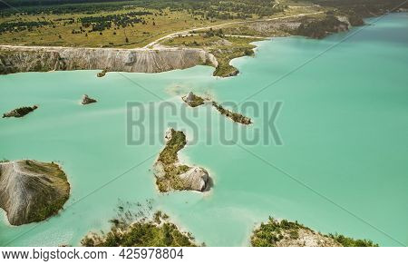 Green In Big Quarry Water Aerial Drone View On Bright Sunny Day