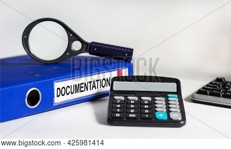 Blue Folder With Label Documentation On A White Background. Compliance And Rules