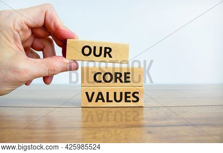 Our Core Values Symbol. Wooden Blocks With Words 'our Core Values'. Beautiful Wooden Table, White Ba