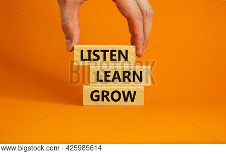 Listen, Learn And Grow Symbol. Wooden Blocks With Concept Words Listen, Learn, Grow. Beautiful Orang