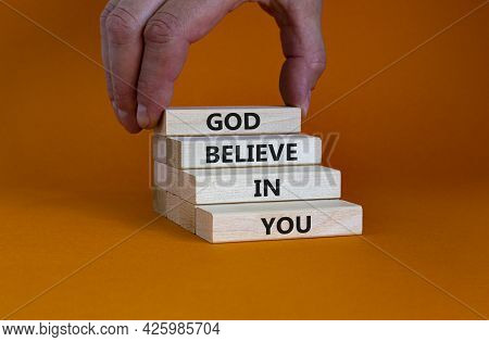 God Believe In You Symbol. Concept Words 'god Believe In You' On Wooden Blocks On A Beautiful Orange