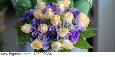 Close Up Of Tender Bouquet Of Beautiful Tea-colored Rose And Colorful Delicate Purple Flowers, A Flo
