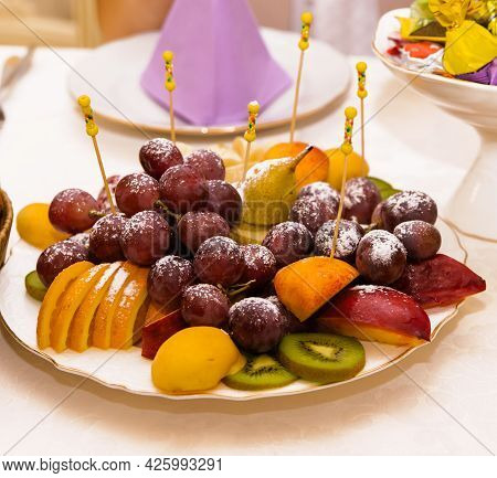 The Chopped Fruits Are Lying On The Terelka. Beautiful Decor Of The Festive Table. Serving Fruit At