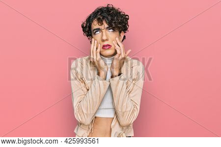 Handsome man wearing make up and woman clothes tired hands covering face, depression and sadness, upset and irritated for problem
