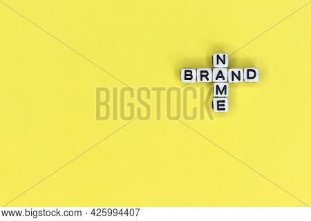 Name Brand Is A Word Written On A White Block. Name Brand Is The Word For Your Design, Concept.