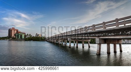Blue Sky Over Bridge Over Hickory Pass Leading To The Ocean In Bonita Springs, Florida.