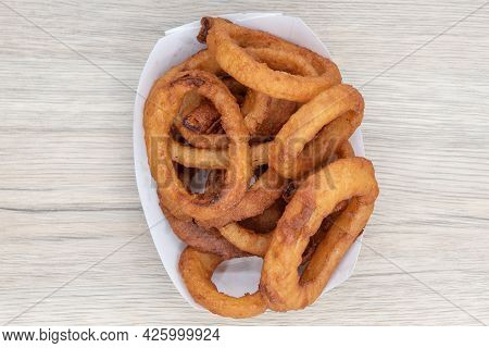 Overhead View Of Side Order Of Onion Rings Are Delicious To Eat All By Themself As Well.