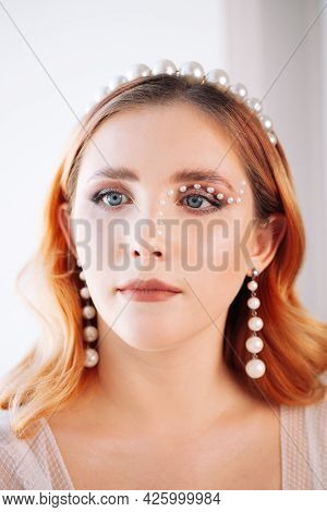 Close-up Portrait Of A Red-haired And Lop-eared Woman With Pearl Makeup, A Pearl Headband On Her Hea